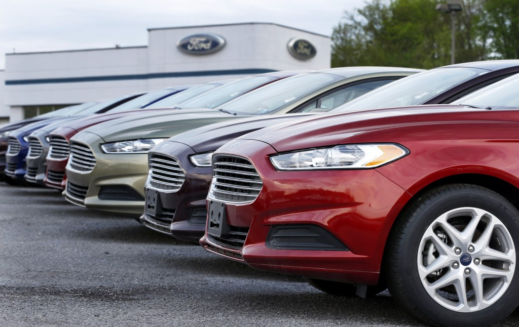 In this Wednesday, May 8, 2013 file photo, a row of new 2013 Ford Fusions are on display at an automobile dealership in Zelienople, Pa. (AP Photo/Keith Srakocic, File)