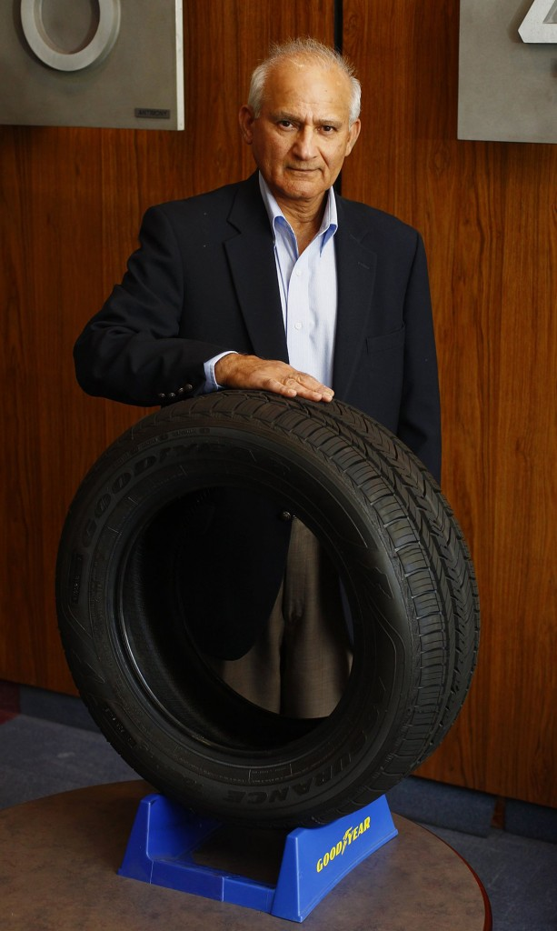 Surendra K. Chawla, senior director of the External Science and Technology program, stands with a tire, made of rice husk ash, that The Goodyear Tire & Rubber Company has developed, at Goodyear's research center in Akron, Ohio. (Karen Schiely/Akron Beacon Journal/MCT)