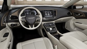 The center console slopes down from the dashboard to the armrests, putting controls within easy reach. (Chrysler/MCT)