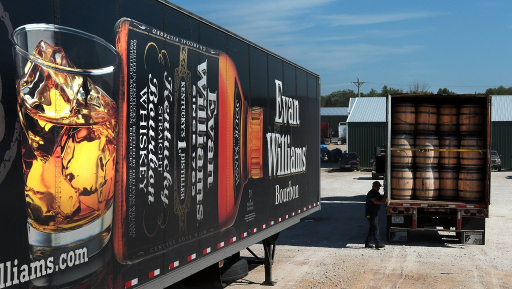 A trailer loaded with 288 whiskey barrels heads for Heaven Hill Distilleries, maker of Evan Williams bourbon, as it leaves McGinnis Wood Products in Cuba, Mo., on Friday, Sept. 5, 2014. (Robert Cohen/St. Louis Post-Dispatch/MCT)
