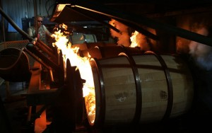 Once the white oak barrels are pieced together and shaped, they are charred. A propane-fed fire sets the interior ablaze, burning for 35 seconds for an average spirit barrel. The charred surface removes impurities and gives the whiskey its color. McGinnis Wood Products of Cuba, Mo., is the third-largest manufacturer of spirit barrels. Originally founded by Leroy McGinnis with eight employees in 1968, it now has a workforce of 155. (Robert Cohen/St. Louis Post-Dispatch/MCT)