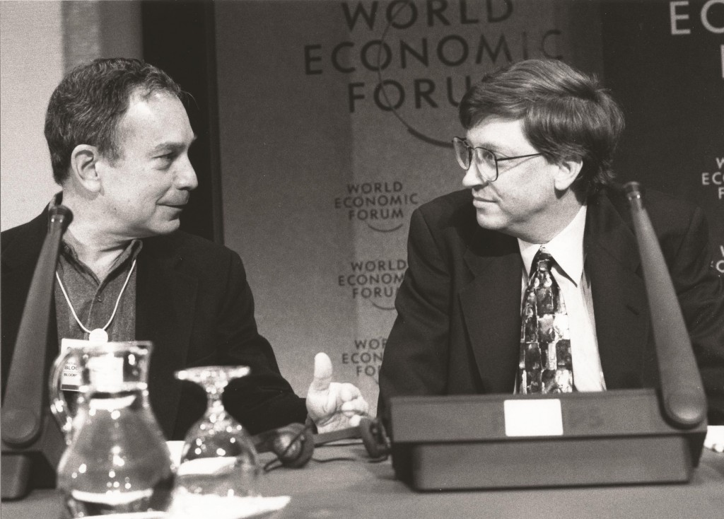 Then-Bloomberg LP CEO Michael Bloomberg confers with Bill Gates of Microsoft at the World Economic Forum in Davos, Switzerland, in 1996. (World Economic Forum)