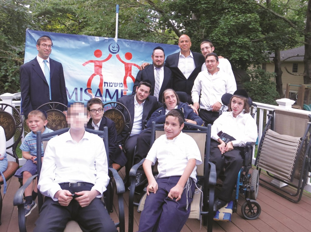 Sen. Cory Booker (D-N.J.) (Standing, 3rd R) on Sunday attended an event with cancer-stricken children organized by Misameach in Lakewood Committeeman Meir Lichtenstein's backyard. (One child requested that his face be blurred.) (Misameach)