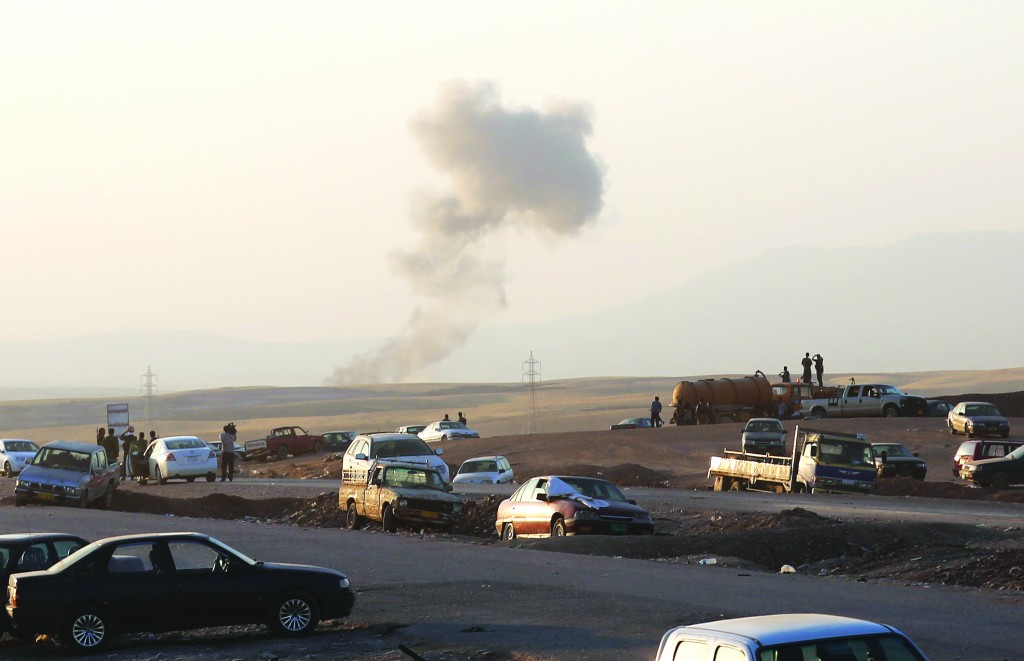 Smoke rises after recent airstrikes targeting Islamic State near the Khazer checkpoint outside of the city of Irbil in northern Iraq. (AP Photo/Khalid Mohammed)
