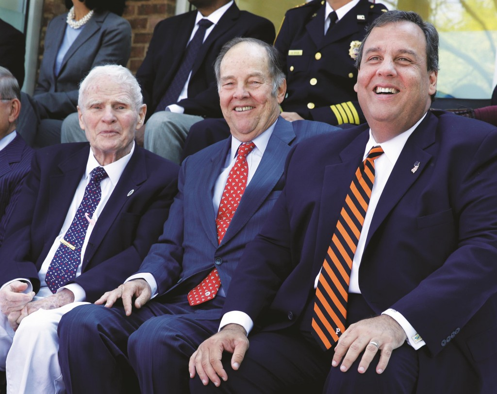New Jersey Gov. Chris Christie (R) sits Monday with his predecessors Brendan Byrne (L) and Thomas Kean at the opening of a new prisoner re-entry center in Jersey City. (AP Photo/Mel Evans)