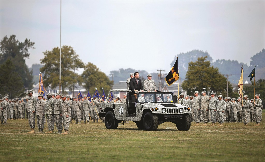 Gov. Chris Christie on Sunday reviews troops during the New Jersey National Guard's annual Military Review in Sea Girt, N.J. (AP Photo/Mel Evans)
