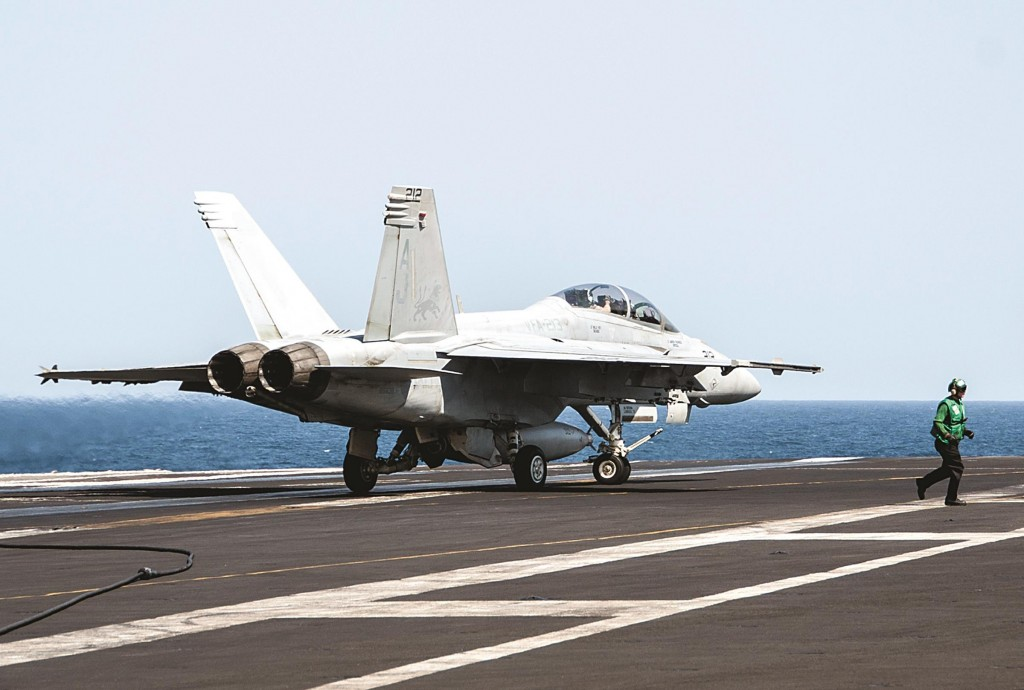 Specialist 3rd Class Brian Stephens A F/A-18F Super Hornet attached to the Fighting Black Lions of Strike Fighter Squadron lands aboard the aircraft carrier USS George H.W. Bush in the Persian Gulf on Tuesday, after conducting strike missions against Islamic State group targets inSyria.  (AP Photo/U.S. Navy, Mass Communication)