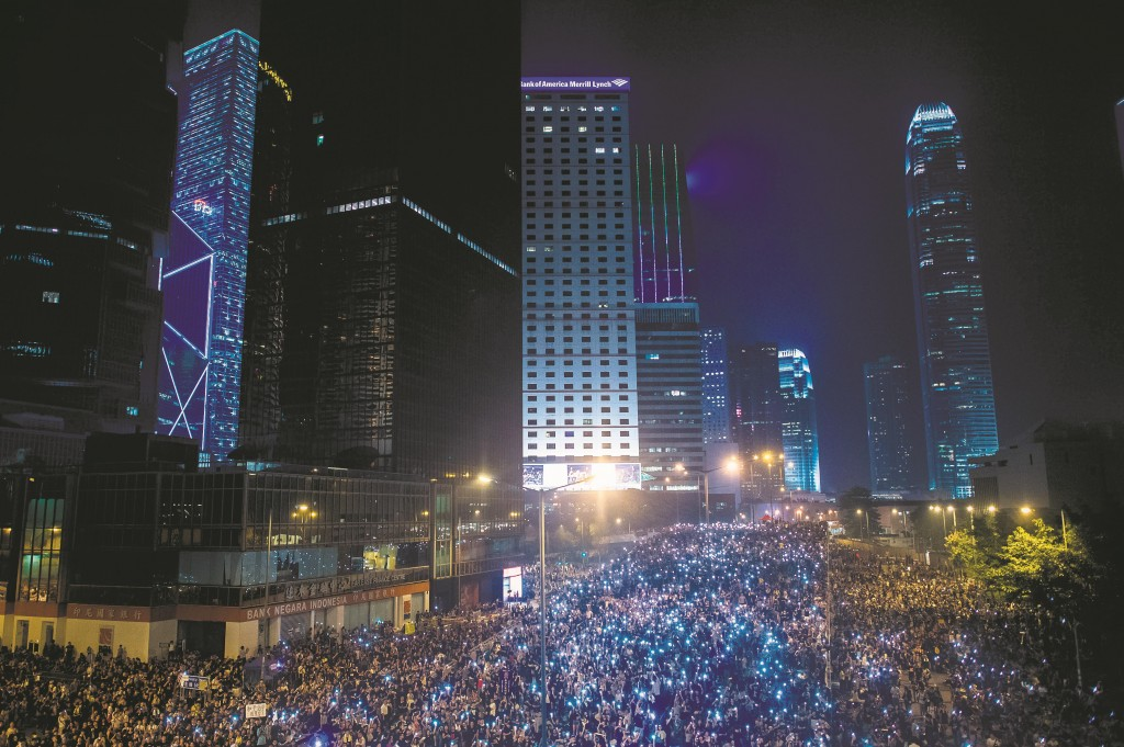Pro-democracy demonstrators gather for the third night in Hong Kong, Tuesday.  (PHILIPPE LOPEZ/AFP/Getty Images)