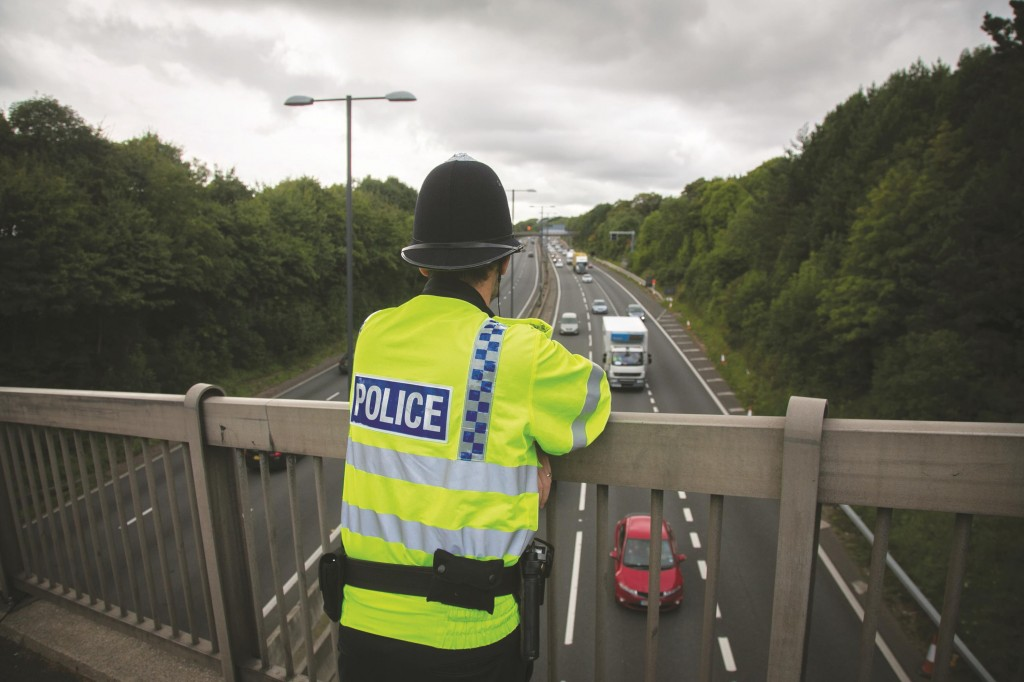 A police officer watches the M4 motorway running near the Celtic Manor Resort ahead of the NATO Summit 2014 being held in South Wales this week in Newport, Wales. Preparations for the international conference are being stepped up in both Cardiff and also at the Celtic Manor Resort in Newport, which will see 150 world leaders including Barack Obama later this week. (Matt Cardy/Getty Images)