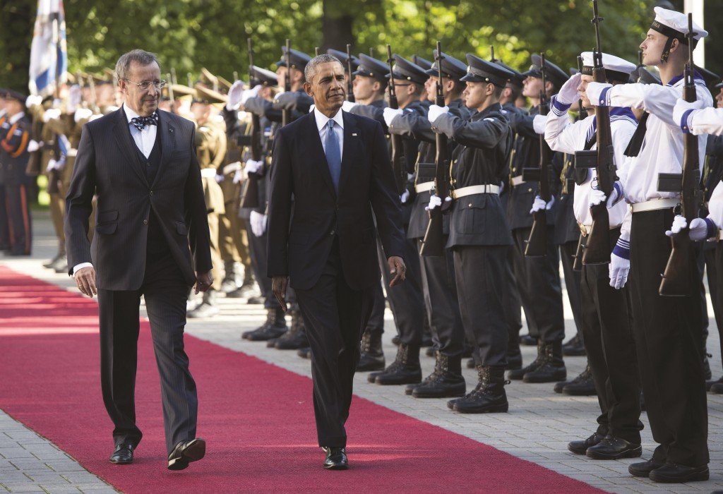 Estonian President Toomas Hendrik Ilves (L) and President Barack Obama review an honor guard during an arrival ceremony prior to meetings at the Kadriorg Palace in Tallinn, Estonia. (SAUL LOEB/AFP/Getty Images)