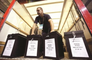 A man carries ballot boxes at a counting center in Edinburgh, Scotland, Thursday. (REUTERS/Paul Hackett)