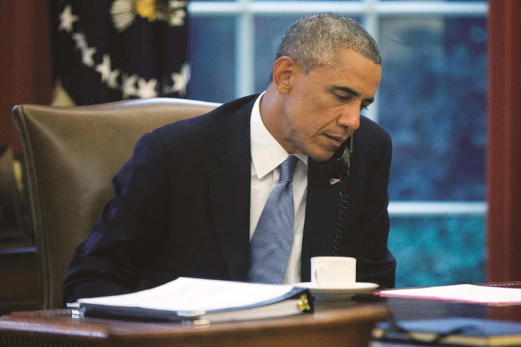 In this image made through a window of the Oval Office, President BarackObama speaks on the phone to Saudi Arabia's King Abdullah from his desk at the White House in Washington, Wednesday. (AP Photo/Charles Dharapak)