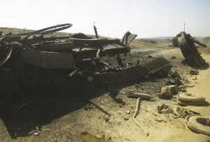 A column of destroyed Ukrainian military vehicles are abandoned near the village of Novokaterynivka, eastern Ukraine, Tuesday. (AP Photo/Sergei Grits)
