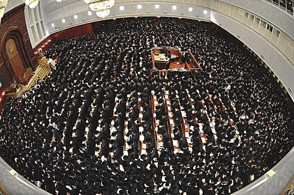 Jews gather for the first day of Selichos in the Belz beis medrash, Motzoei Shabbos, in Eretz Yisrael. (Photo Credit: Anshi Beck/JDNwFir)
