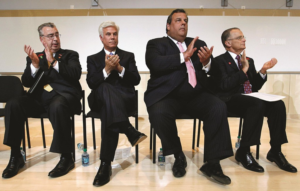 The late John Sheridan (L) at a July 24, 2012, event with Gov. Chris Christie (second R). (AP Photo/Mel Evans)