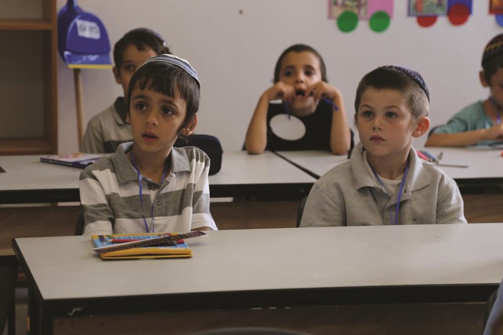Young students seen learning in the classroom of Talmud Torah Ohalei Menachem in Beitar Illit, August 27, Rosh Chodesh Elul. (Nati Shohat/Flash90.)