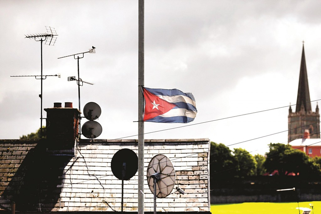 The flag of Cuba flies in the Nationalist Bogside area of Londonderry. Republicans have strong links with Cuba which culminated in Sinn Fein President Gerry Adams meeting with former Cuban leader Fidel Castro.  (REUTERS/Cathal McNaughton)