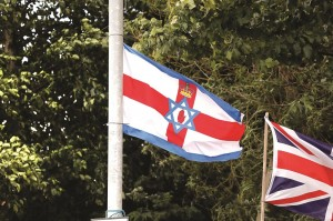 A flag comprised of various elements including the Ulster Banner and the Star of David flies on the interface of Twaddell avenue and Nationalist Ardoyne in North Belfast. (REUTERS/Cathal McNaughton)