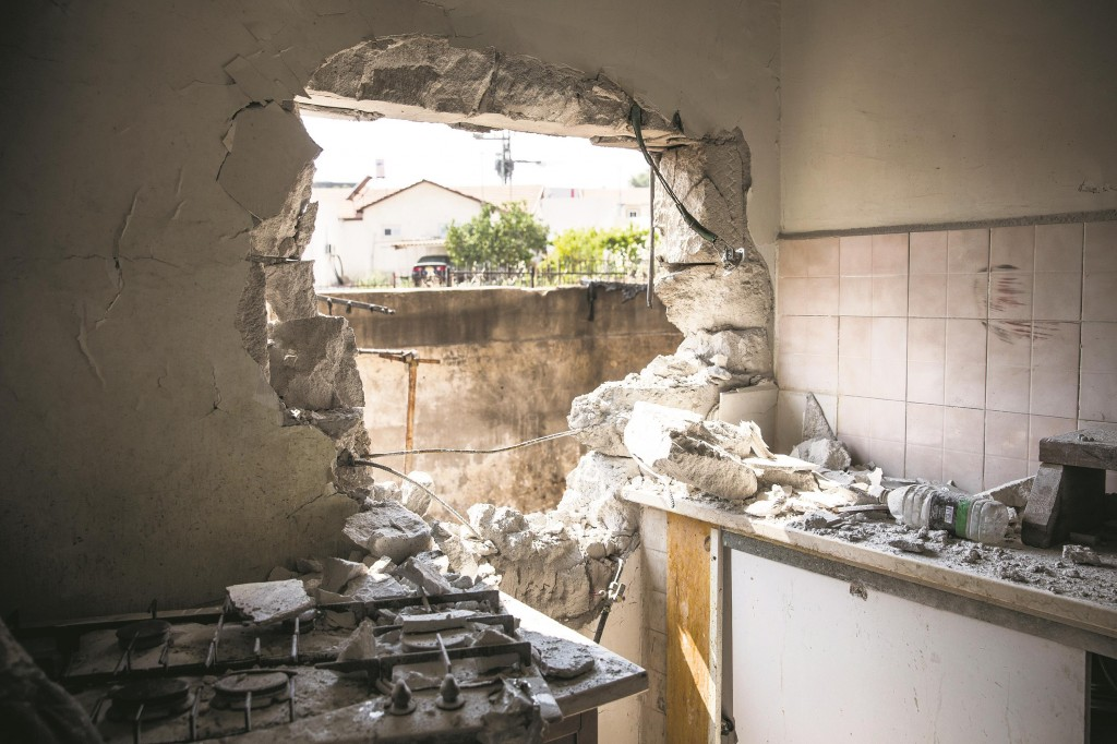 In a July 21 file photo, a hole caused by a Hamas rocket is seen in an Israeli home in Sderot, Israel.  (Andrew Burton/Getty Images)