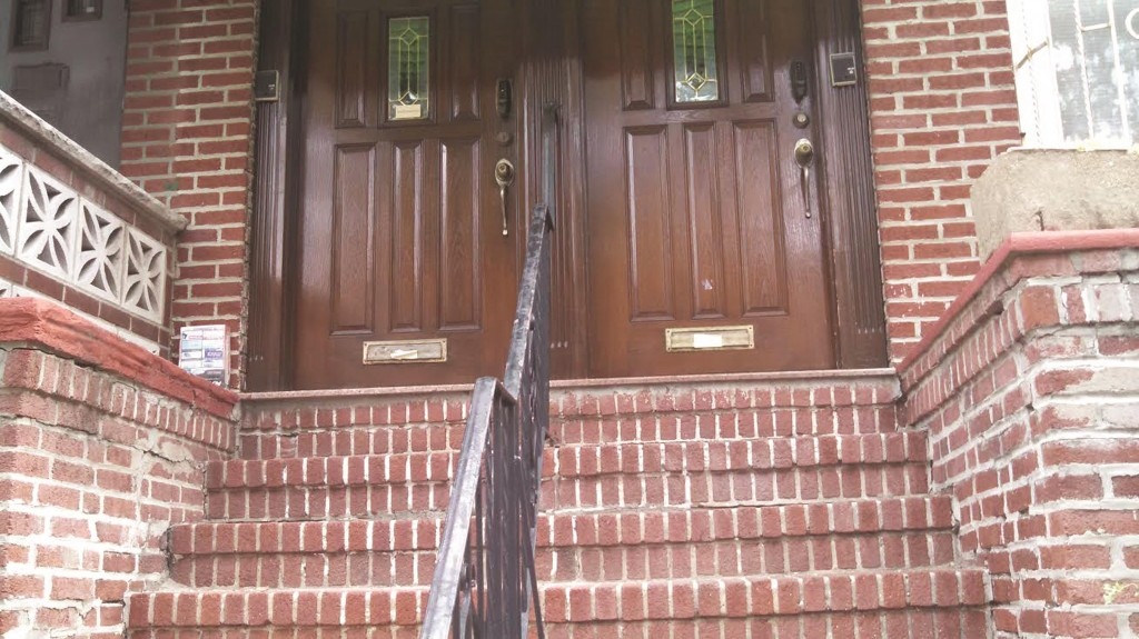 A house on Boro Park's 46th Street which received a letter from the Post Office ordering them to raise the mail slots or lose postal services.