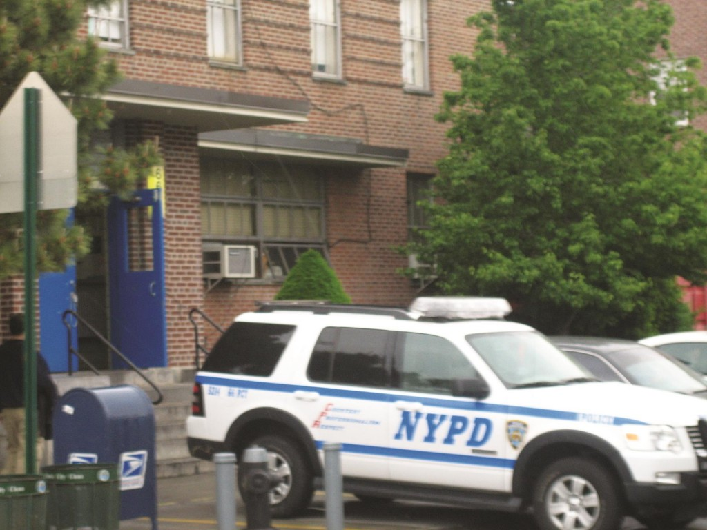 A police cruiser is parked in front of the headquarters for the 66th Precinct on Boro Park's 16th Avenue. (Flickr)