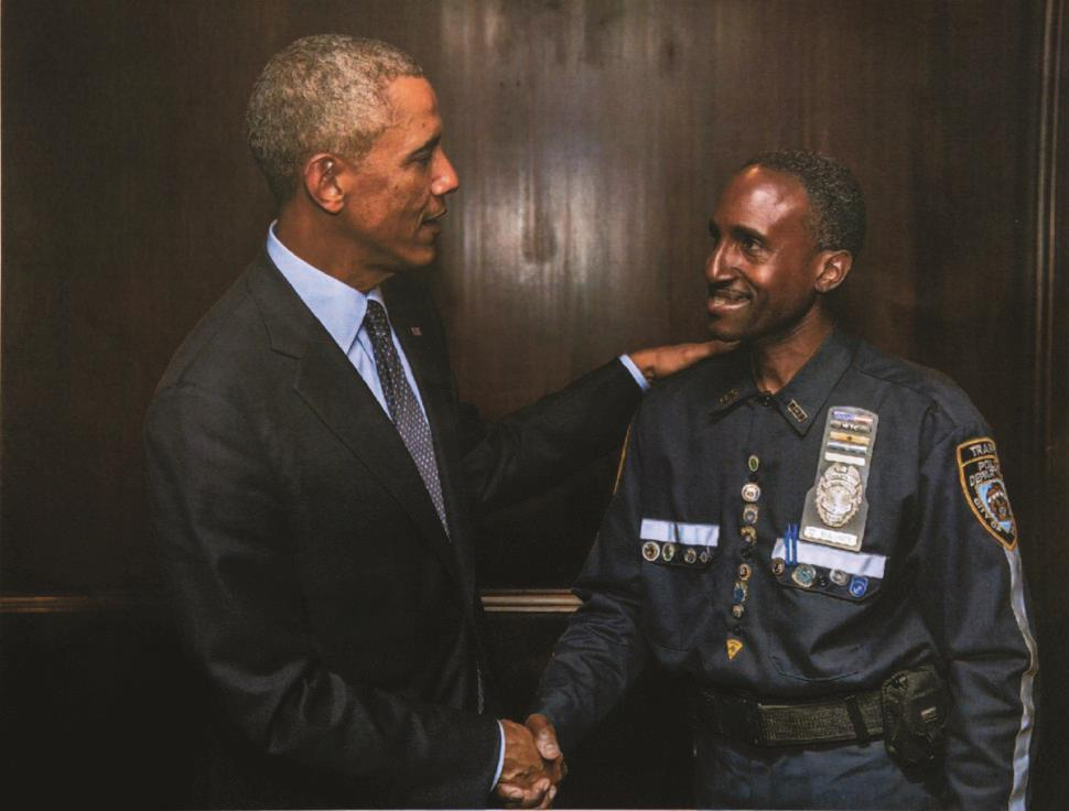 resident Barack Obama met traffic-enforcement agent Clarence Baugh in Manhattan on Tuesday. (Pete Souza/White House)