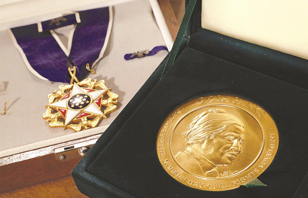 Rosa Parks' Presidential Medal of Freedom, left, and her Congressional Gold Medal. (AP Photo/Richard Drew)
