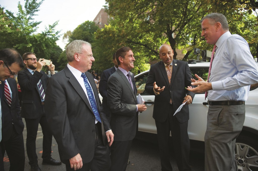 Mayor Bill de Blasio (R) on Monday announces the installation of speed cameras citywide near schools. (Rob Bennett/Mayoral Photography Office)