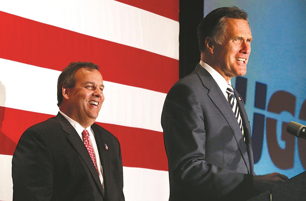 Gov. Chris Christie (L) on Wednesday laughs while Mitt Romney speaks at an event celebrating Christie's 52nd birthday. (AP Photo/Julio Cortez)