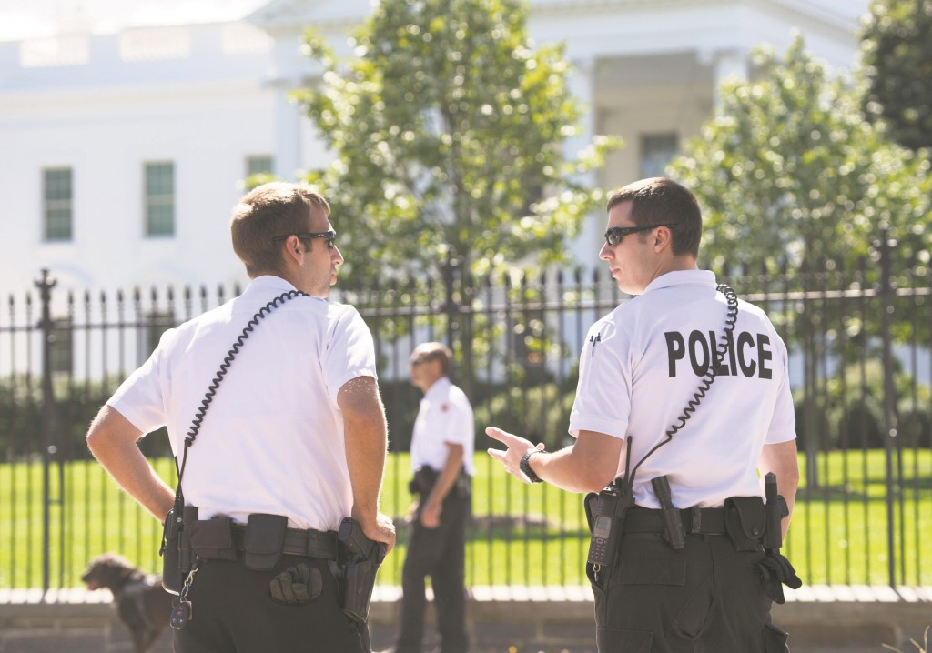 Members of the Secret Service Uniformed Division stand guard outside the White House in Washington, DC, Monday. (SAUL LOEB/AFP/Getty Images)