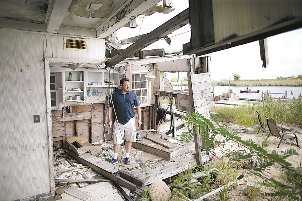 Gary Silberman guides reporters on a tour of his parent's home that was destroyed by Superstorm Sandy, in Lindenhurst, N.Y. After receiving nearly $17,000 in assistance from FEMA, the agency wants the funds back. (AP Photo/John Minchillo)