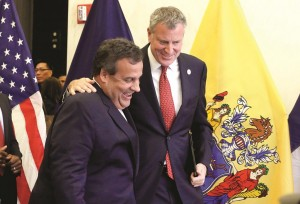 New Jersey Gov. Chris Christie (L) and New York City Mayor Bill de Blasio leave a press conference Monday following a security meeting in New York with Homeland Security Secretary Jeh Johnson. (AP Photo/Richard Drew)