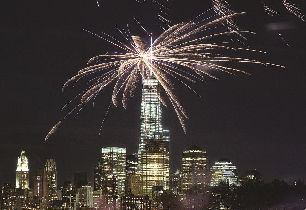 Fireworks launched from Hoboken, N.J., on Sunday light up the sky over 1 World Trade Center as part of the Hoboken Italian Festival. (AP Photo/Mark Lennihan)