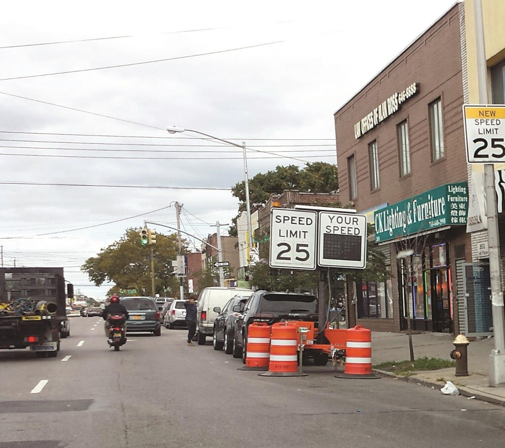 A new speed limit is posted on Monday on Midwood's Coney Island Avenue, down from the original 30 mph. Speed limits are being lowered across the city as part of Mayor Bill de Blasio's Vision Zero initiative. (Hamodia Photo)