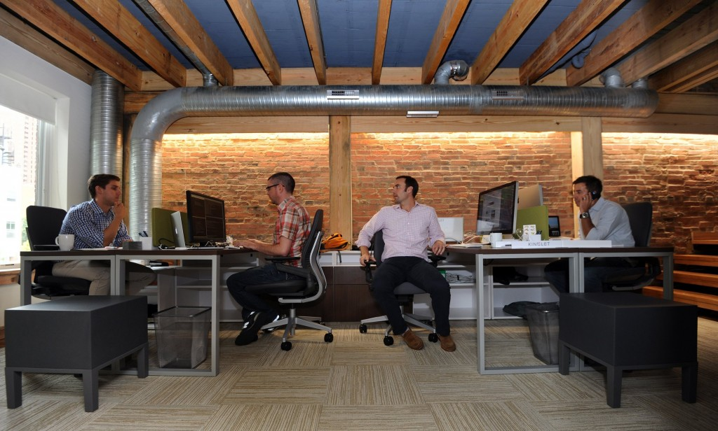 Kinglet has built a website to connect small companies to real estate. Seated at their desks are, from left, EJ Rumpke, Mike Vess, co-founder Alex Kopicki and co-founder Jeff Jacobson. (Algerina Perna/Baltimore Sun/MCT)