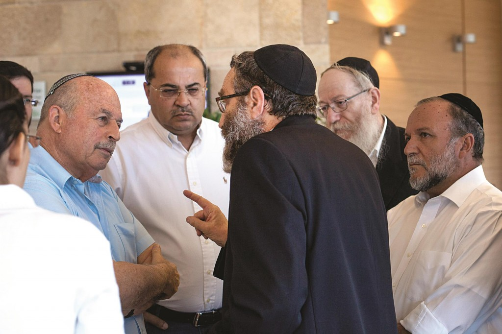 Chairman of the Finance committee, Nissan Slomiansky (L), listening to UTJ MK Rabbi Moshe Gafni (C) in the Knesset on Monday. (Noam Revkin Fenton/Flash90)