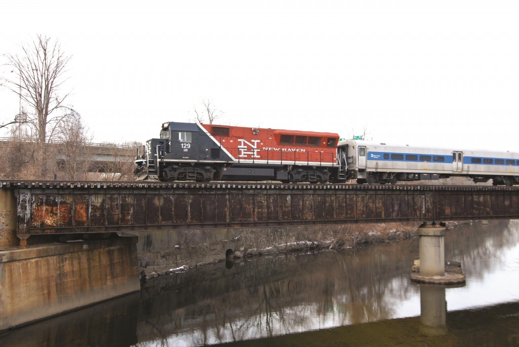 A Metro-North train crosses the Naugatuck River in Waterbury, Conn., after leaving the Waterbury station. (Flickr)