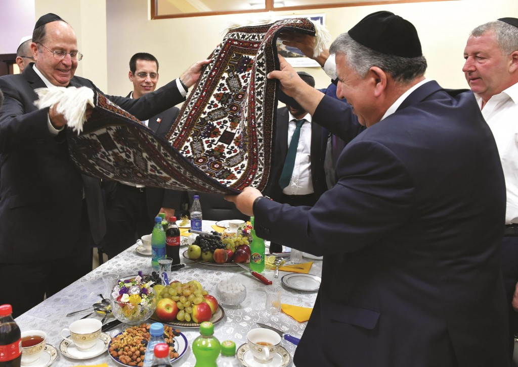"""Defense Minister Moshe Yaalon (L) is hosted by the leaders of the local Jewish community in Baku, Azerbaijan. Yaalon is the first Israeli defense minister to visit this Central Asian country, and he had warm words for both the Azerbaijani government and the Jewish community. """"Cooperation between the countries is flourishing. There are strategic relations between the countries, and cooperation in a number of fields. Here in Azerbaijan, there is a Jewish community with a magnificent history, which enjoys extraordinary treatment allowing it to live honorably. We very much value that,"""" Yaalon said."""