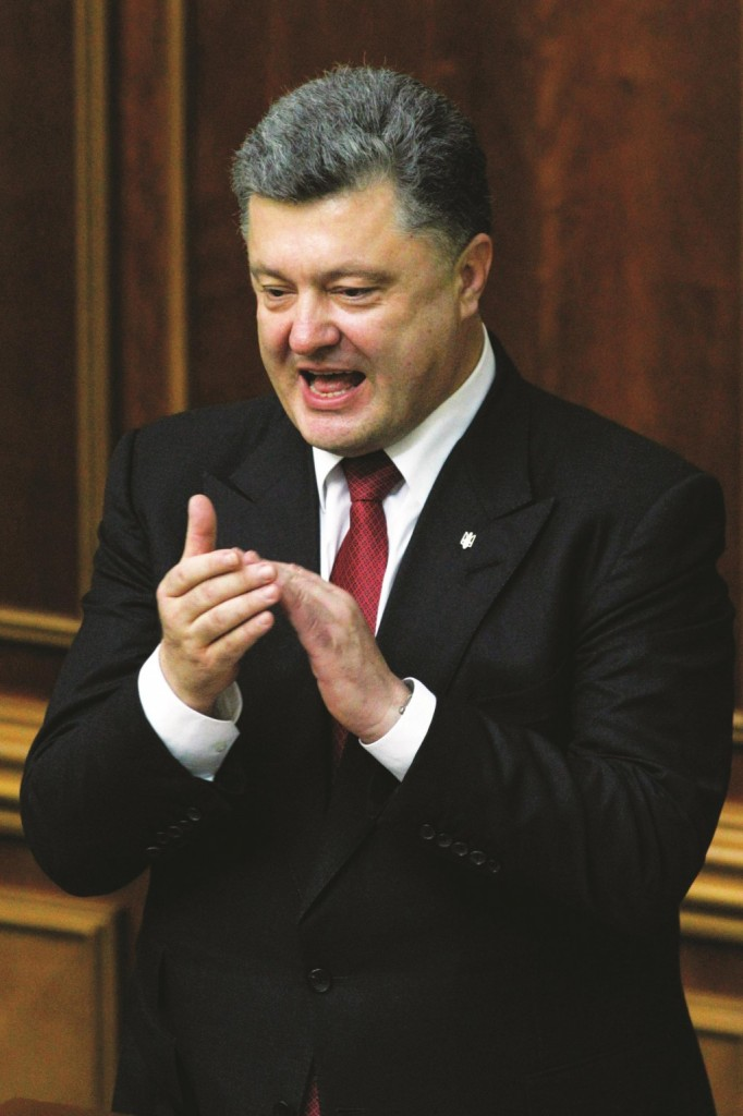 Ukraine's President Petro Poroshenko applauds after the ratification of a landmark association agreement with the European Union during a parliament session in Kiev on Tuesday. (REUTERS/Valentyn Ogirenko)