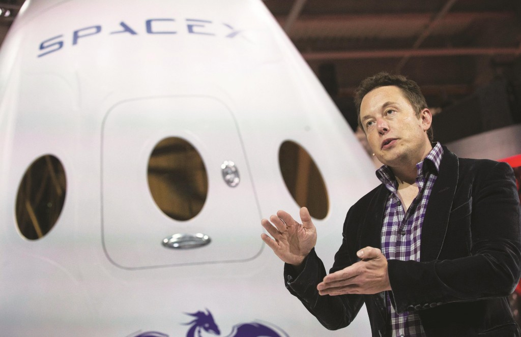 Elon Musk, CEO and CTO of SpaceX, introduces the SpaceX Dragon V2 spaceship at the SpaceX headquarters in Hawthorne, Calif, May 29, 2014. (AP Photo/Jae C. Hong, file)