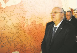 Israeli President Reuven Rivlin walks past a historical map of Poland as he tours the museum during the opening of the core exhibition, Tuesday, Oct. 28, 2014.  (AP Photo/Alik Keplicz)