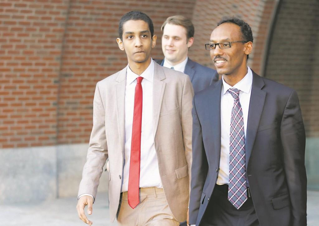 Robel Phillipos (L), a college friend of Boston Marathon bombing suspect Dzhokhar Tsarnaev, departs federal court with defense attorney Derege Demissie (R). (AP Photo/Steven Senne)
