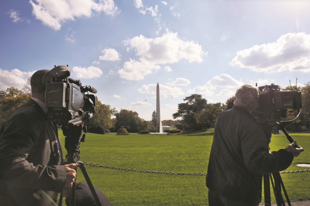 Members of the media record as the Marine One helicopter carries President Obama from the South Lawn of the White House, Thursday, in Washington. The president was en route to attend campaign and fundraising events in Maine and Rhode Island.  (AP Photo/Jacquelyn Martin)