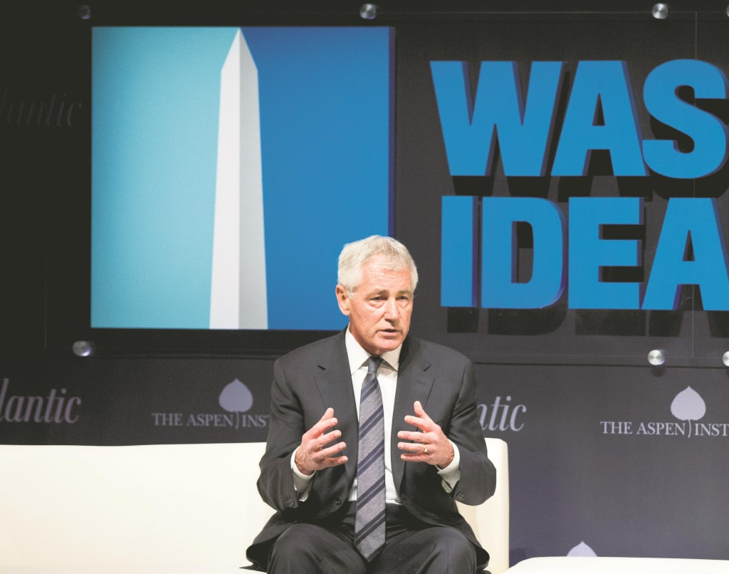 Defense Secretary Chuck Hagel speaks at the sixth annual Washington Ideas Forum in Washington, Wednesday. Hagel has approved a recommendation by military leaders that all U.S. troops returning from Ebola response missions in West Africa be kept in supervised isolation for 21 days.  (AP Photo/Manuel Balce Ceneta)