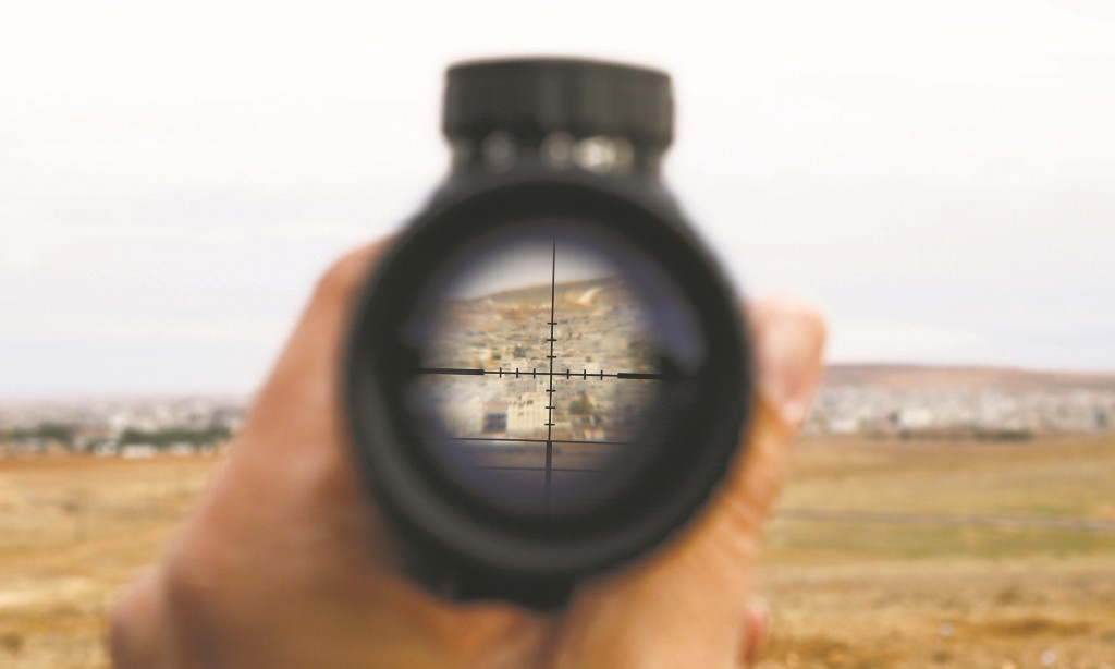 A general view of the Syrian town of Kobani is seen through a spy-glass from near the Mursitpinar border crossing, on the Turkish-Syrian border in the southeastern town of Suruc, Sunday.  (REUTERS/Kai Pfaffenbach)