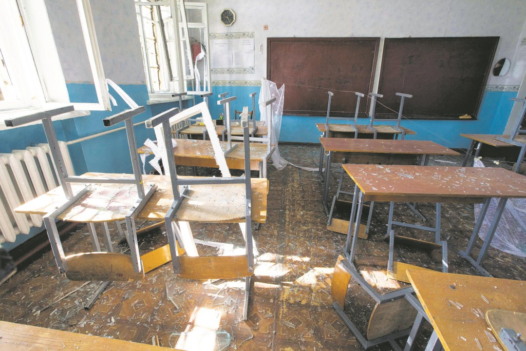A view of a classroom of school No. 57 damaged by recent shelling in Donetsk, eastern Ukraine, Wednesday. (REUTERS/Shamil Zhumatov)