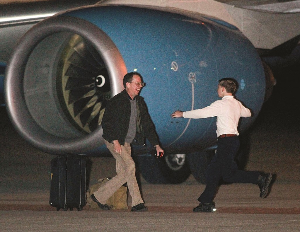 Jeffrey Fowle, who was detained for more than seven months in North Korea, greets his son after arriving at Wright Patterson Air Force Base in Fairborn, Ohio Monday. (REUTERS/Jim Witmer/Dayton Daily News/MCT)