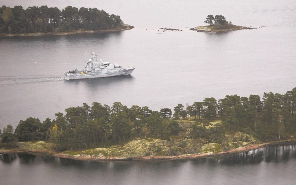 Swedish Navy minesweeper HMS Koster patrols in the Stockholm Archipelago, Sweden, Sunday. The Swedish military's search for evidence of suspected undersea activity in its waters entered its third day on Sunday amid reports of a suspected Russian intrusion.  (AP Photo/TT News Agency/Marko Saavala)