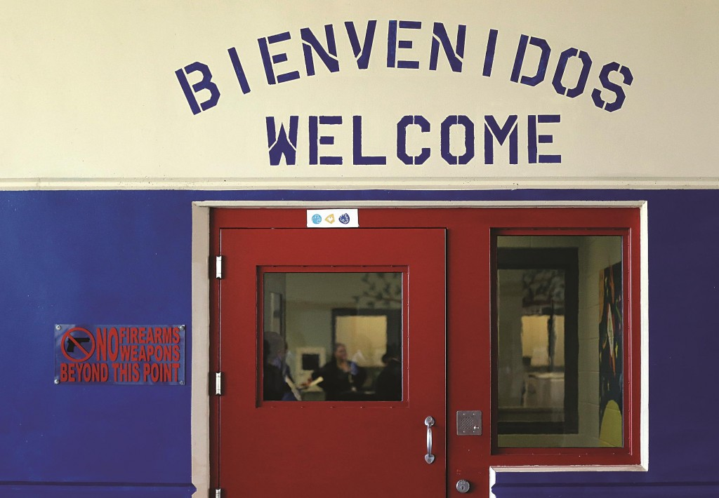 In this July 31, 2014 file photo, a Spanish and English welcome sign is seen above a door in a secured entrance area at the Karnes County Residential Center in Karnes City, Texas. (AP Photo/Eric Gay, File)
