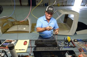 EV Fleet CEO Brooks Agnew makes wire harnesses for the prototypes of the 2015 Condor, an all-electric-powered pickup truck for fleet transport. (Jeff Willhelm/Charlotte Observer/MCT)